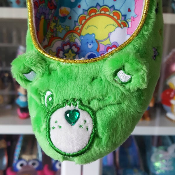 green furry Good Luck Bear Care Bear toe of shoe