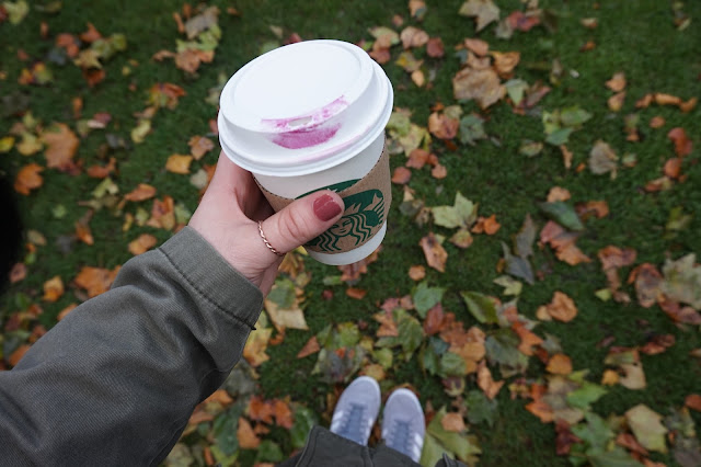 starbucks cup and leaves
