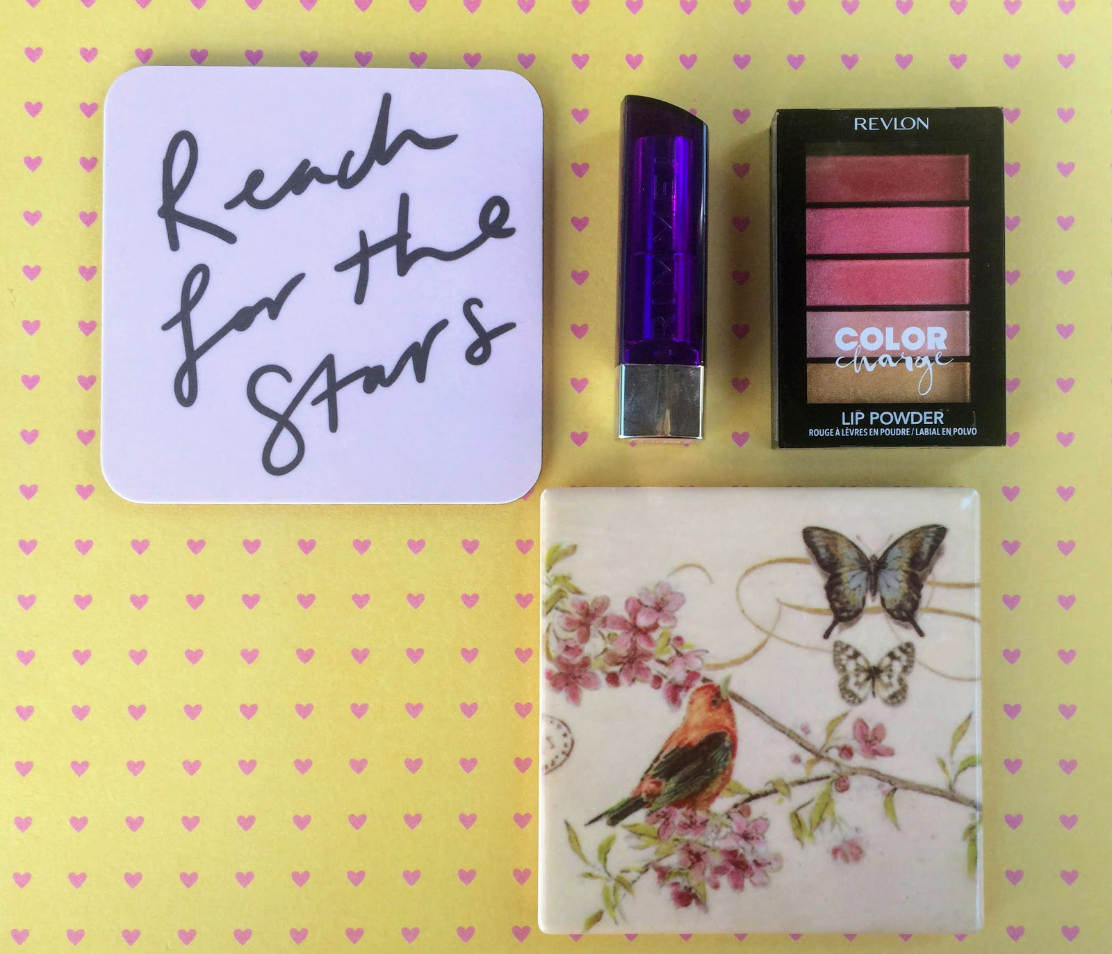 Rimmel lipstick, old english prints coaster, revlon Lip powder