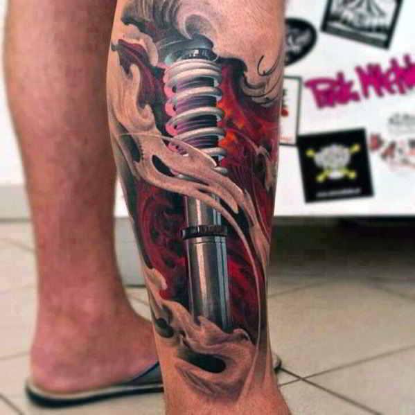 tatuaje suspensión en la pantorrilla