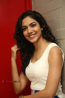 Actress Ritu Varma Stills in White Floral Short Dress at Kesava Movie Success Meet .COM 0111.JPG