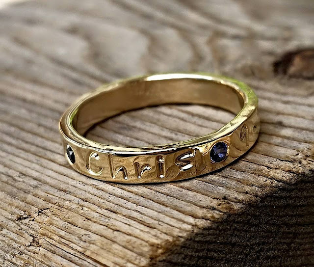mothers ring with flush set gemstones