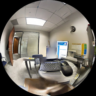 180 degree panoramic of desk and computer in a work office