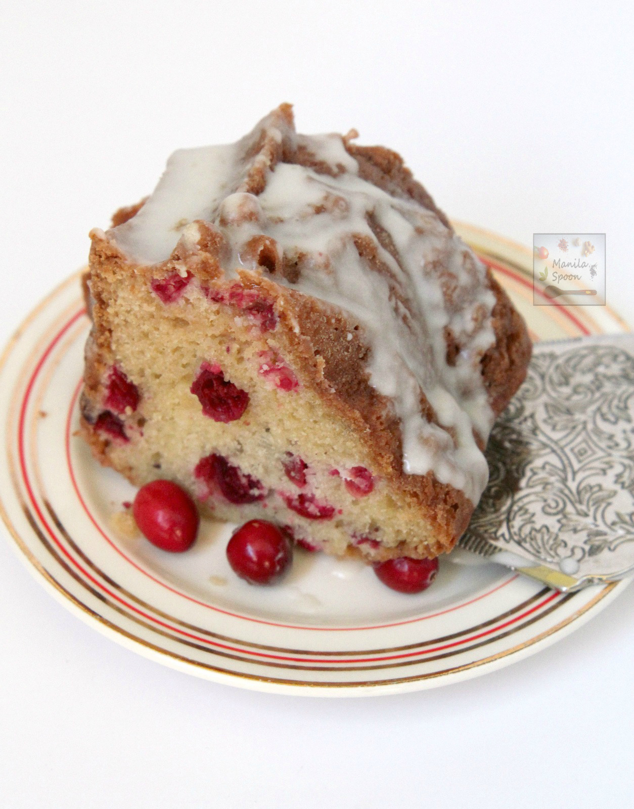 Use fresh, frozen or dried cranberries to make this moist and delicious White Chocolate Cranberry Coffee Cake. Perfect to serve for tea time as well. | manilaspoon.com