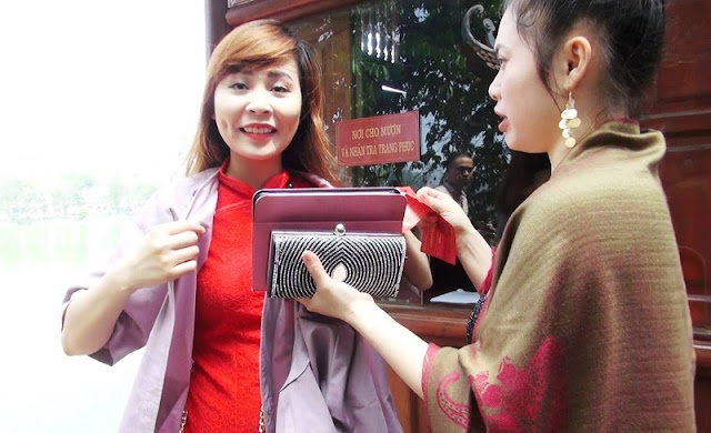 Free proper attire for visitors in Ngoc Son Temple