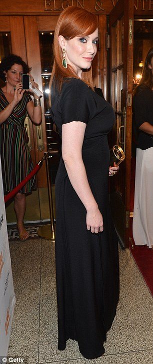 Christina Hendricks Shows Off Some Leg In A Split Black