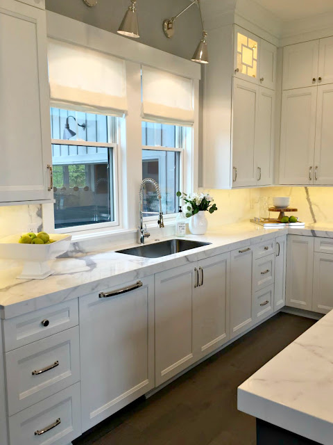 sconces above kitchen sink