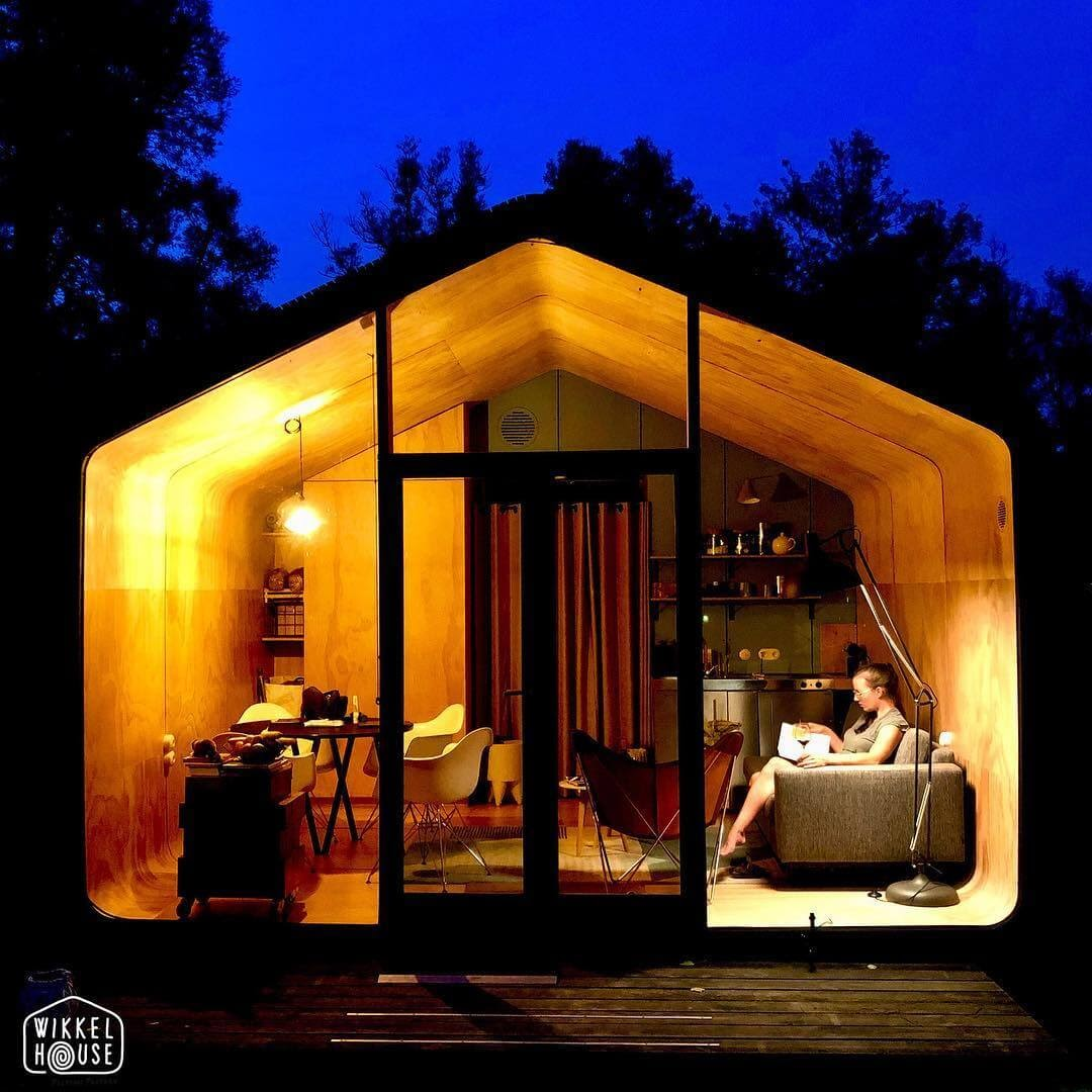 01-Relaxing-at-Night-Fiction-Factory-Wikkel-House-Cardboard-Architecture-www-designstack-co