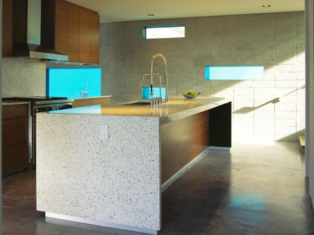 Photo of modern kitchen with the island in the middle