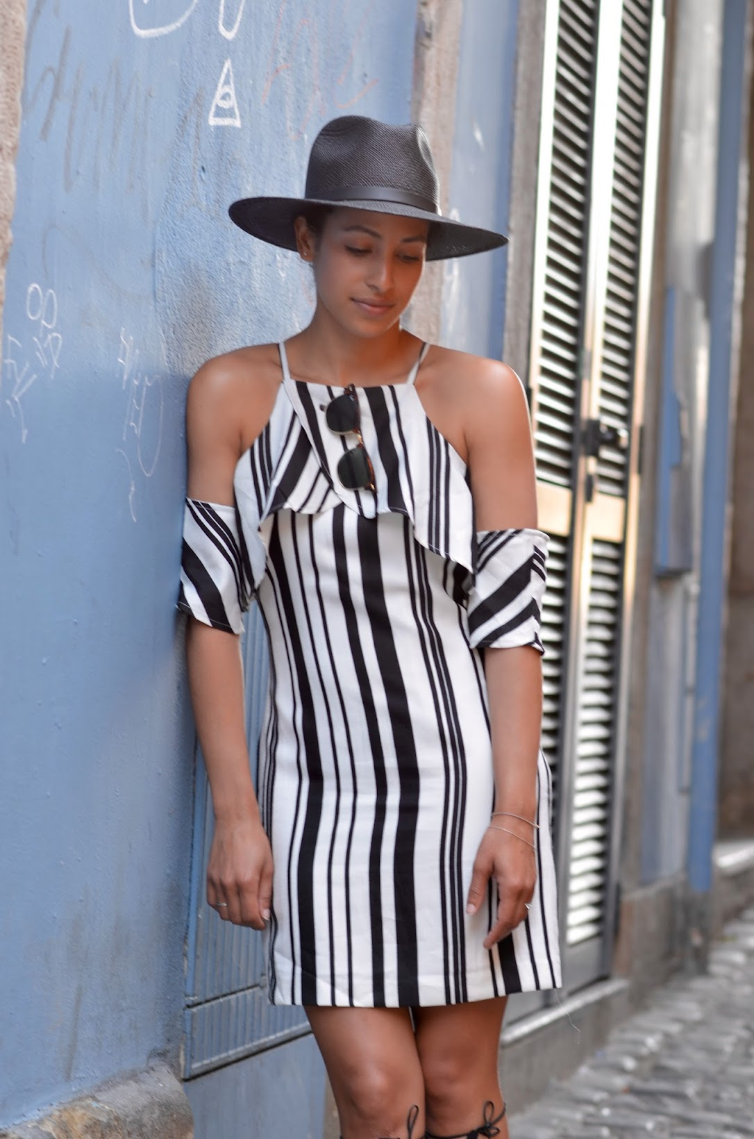 lisbon, portugal, street style in lisbon, what to wear in lisbon, what to wear in portugal, summer style, European vacation, black straw fedora, Goorin Bros straw fedora, striped Joa dress, J.O.A, chic summer vacation style