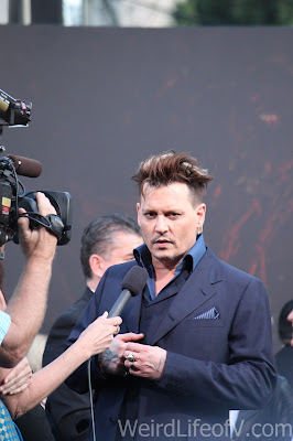 Johnny Depp being interviewed on the red carpet