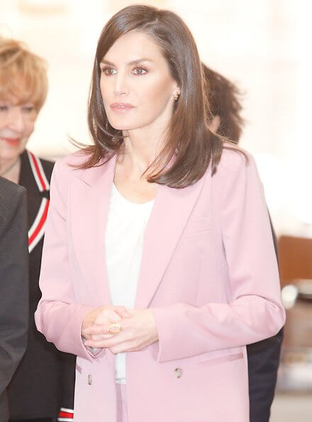 Queen Letizia wore Hugo Boss Jericoa stretch wool double-breasted blazer and trousers. Hugo Boss silk blouse, gold earrings