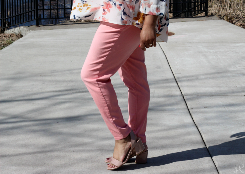 a woman posing in pink jeans