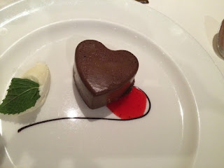 chocolate mousse in the shape of a heart on a white plate