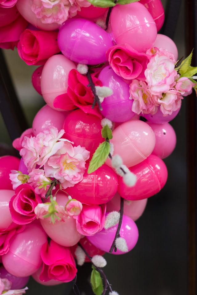 A beautiful DIY spring wreath idea made with plastic eggs and artificial flowers