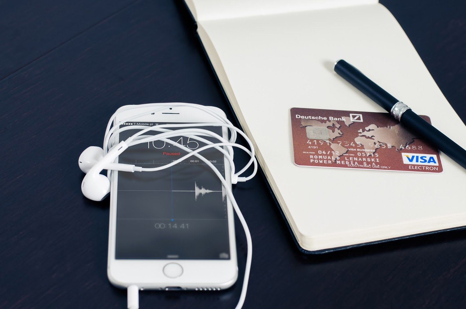 mobile phone and credit card on table