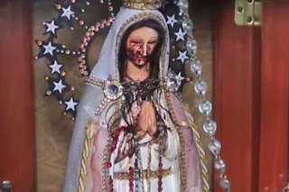 Church worshippers observe Virgin Mary statue crying blood