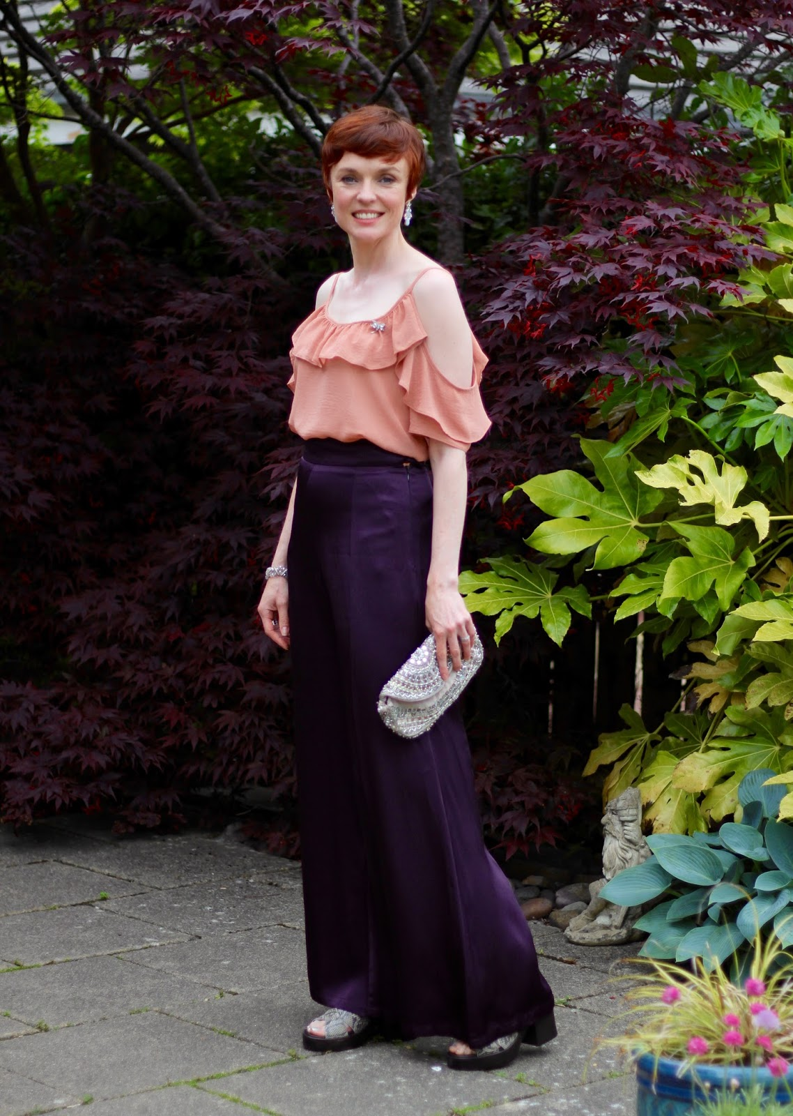 Purple Wide Satin Finery Trousers, Nude ruffle off the shoulder top, vagabond platform sandals | Over 40 | Fake Fabulous