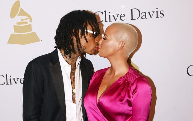 We are not back together - Amber Rose says after kissing Wiz Khalifa
