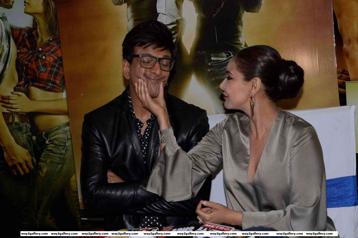 Javed Jaffrey and Lisa Ray share a light moment during a press meet of Ishq Forever