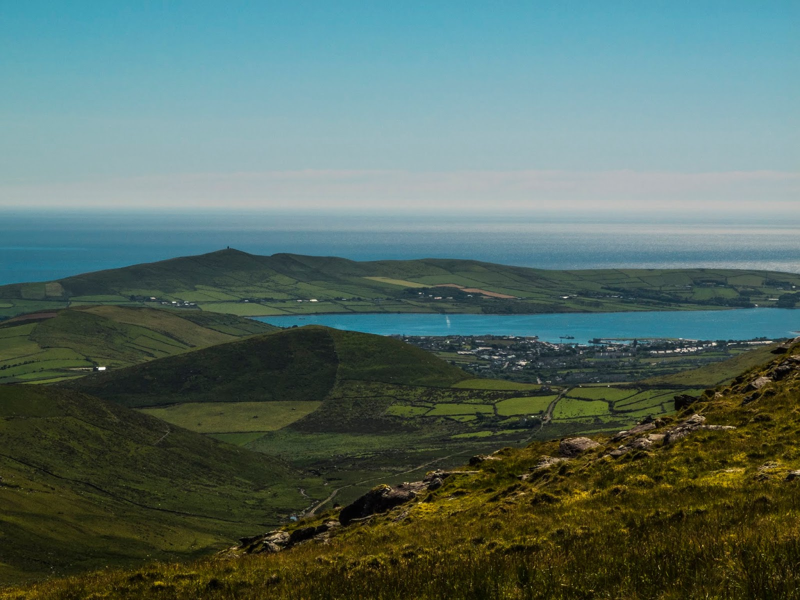 View of Dingle from Conor Pass in Co.Kerry on a sunny day with blue skies.
