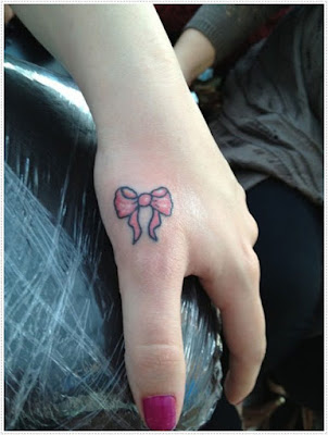 small tattoos for girls, a very intriguing