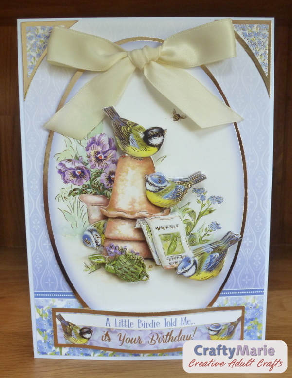 Bird greeting card with dimension and large ribbon bow detail on the front