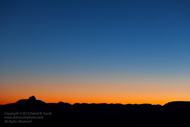 a photo of the sun rising over the palisades of the desert in grand canyon national park
