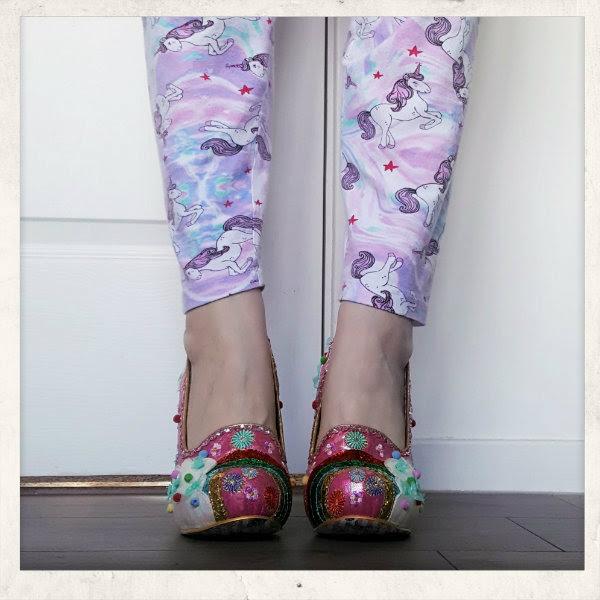 wearing irregular choice cloud rainbow pom pom shoes