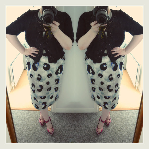 plus size outfit OOTD of asos leopard wiggle dress with black cardigan and Irregular Choice pink and purple cat shoes