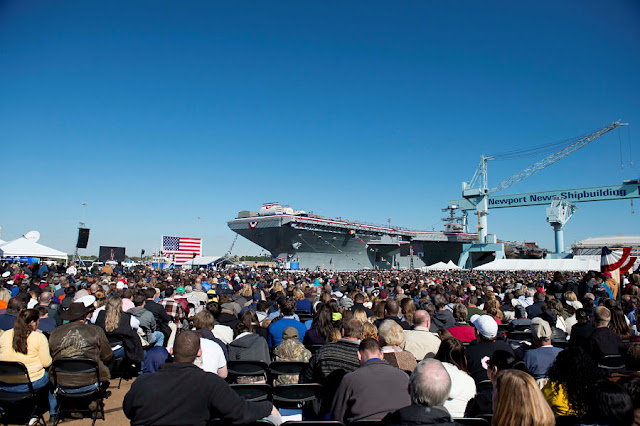 FILE PHOTO: Tens of thousands of Navy supporters attend the christening ceremony of the aircraft carrier Gerald R. Ford (CVN 78) at Newport News Shipbuilding in Newport News, Virginia, U.S. November 9, 2013.  U.S. Navy/Chief Mass Communication Specialist Peter D. Lawlor/Handout via REUTERS/File Photo