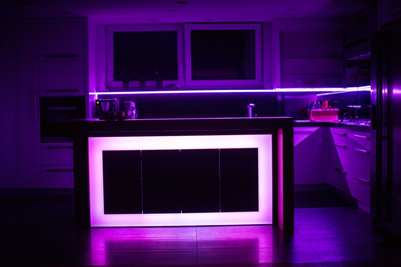 Purple light on kitchen island