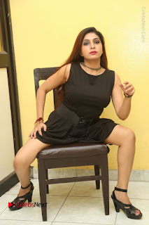 Tollywood Upcoming Actress Pooja Roshan Stills in Black Short Dress at Plus 1 Movie Trailer Launch  0307.JPG
