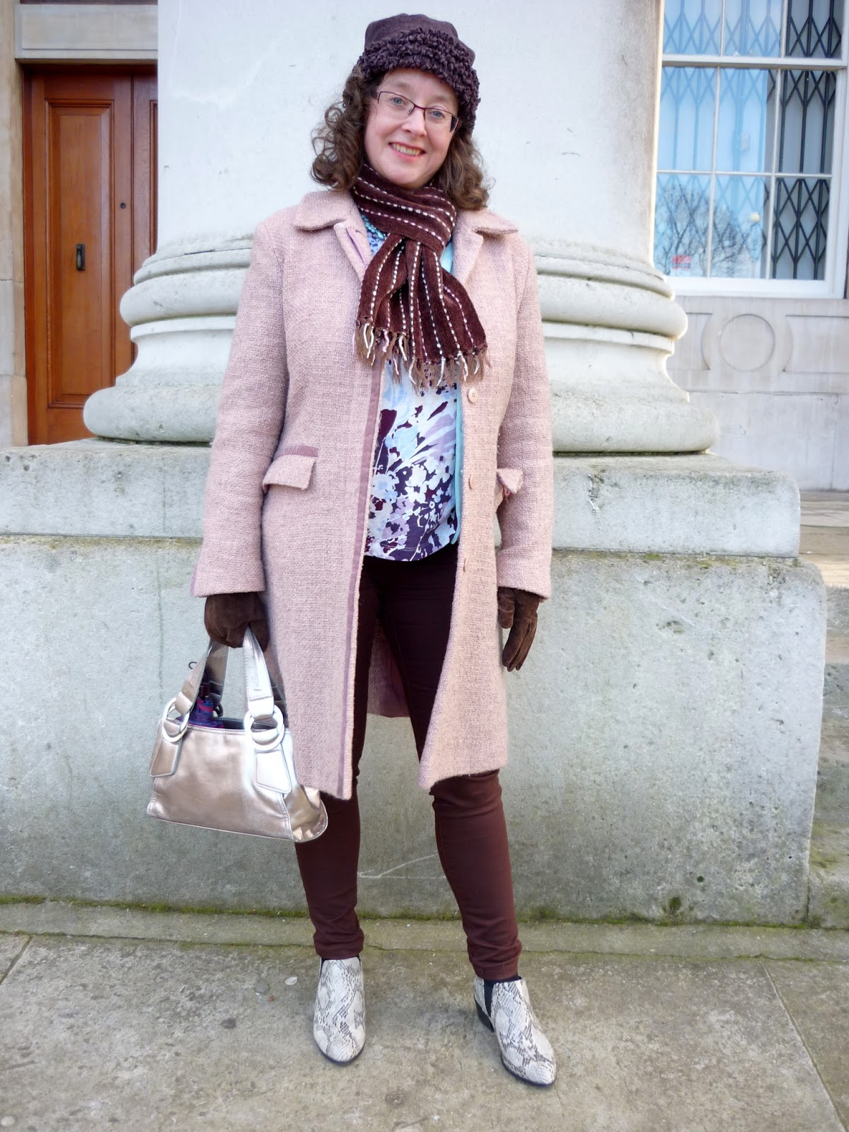 Transitioning to Spring: Pink Coat, Brown Jeans, Snakeskin Boots, Metallic Bag | Petite Silver Vixen, over 40 style