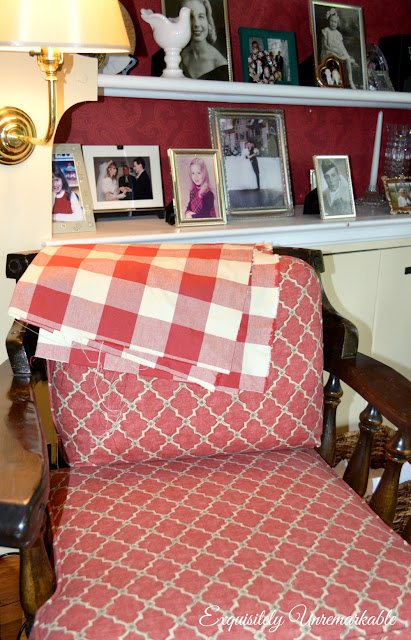 Chair with buffalo check fabric draped over the top