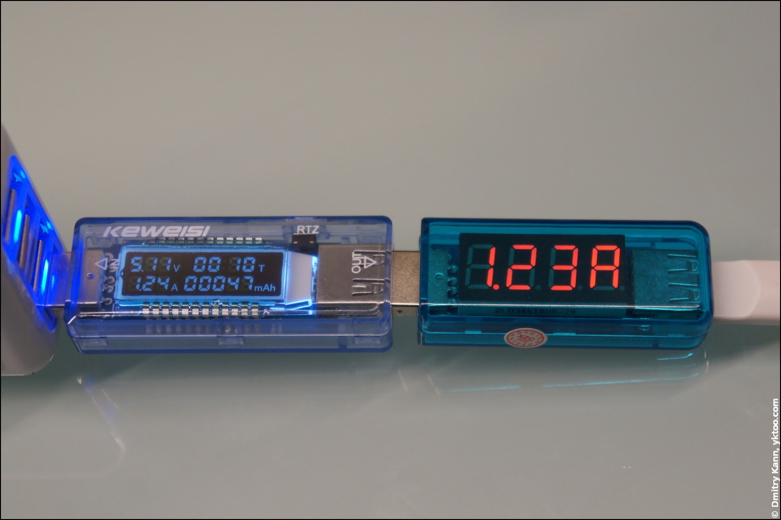 Measuring current by both testers, noname DC adapter 2.1 A.