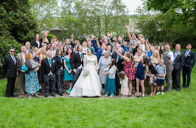 group shot of bride groom and family celebrating