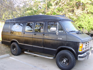 Side view of van painted with bedliner