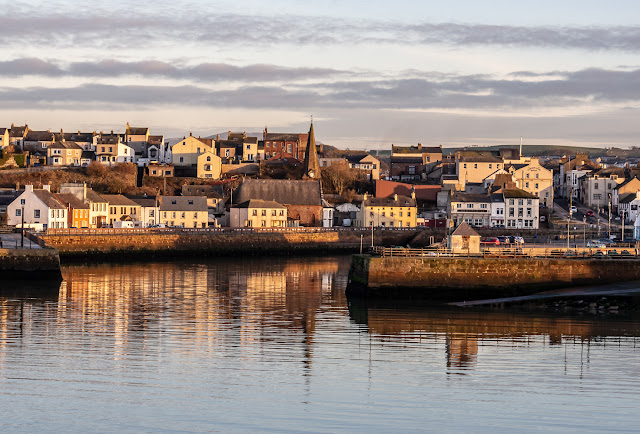 Photo of Maryport town reflected in the still water in Maryport Basin