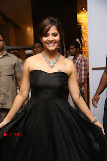 Telugu Anchor Actress Anasuya Bharadwa Stills in Strap Less Black Long Dress at Winner Pre Release Function  0041.jpg