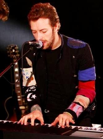 Foto de Chris Martin en concierto más joven