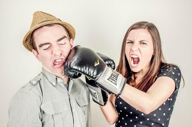 Girl punching boy