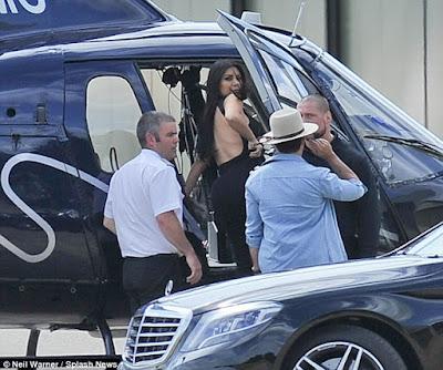 1b Photos: Kim Kardashian goes braless