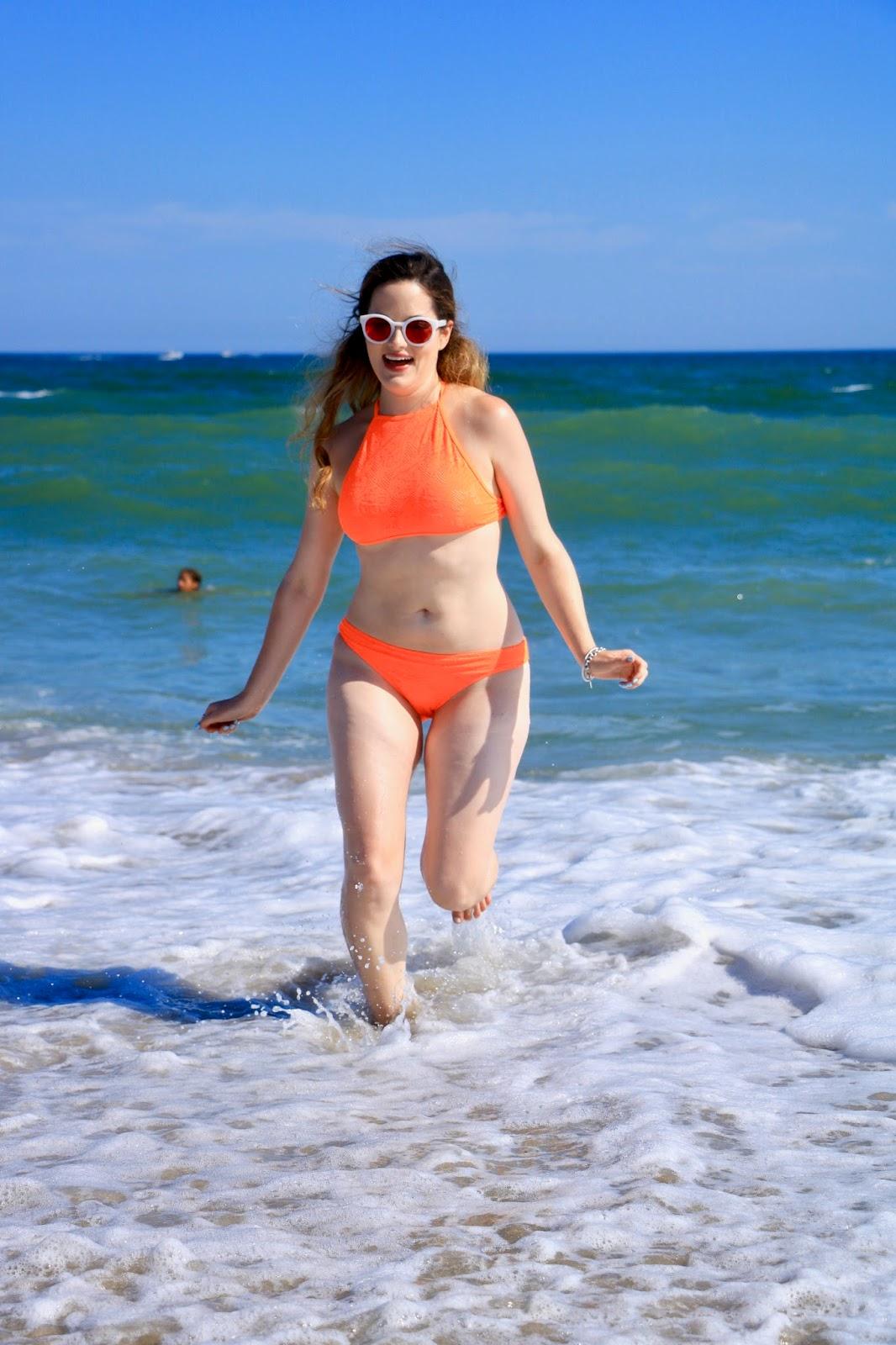 Fashion blogger Kathleen Harper on Rockaway Beach in a bikini