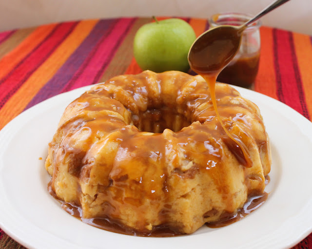 Food Lust People Love: Tart apple, sticky toffee and vanilla custard filled bread come together in this toffee apple bread pudding Bundt to create a dessert that is way more than the sum of its parts.