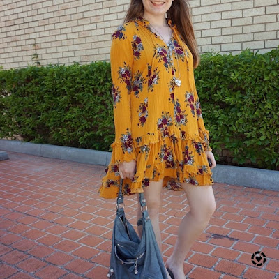 awayfromblue instagram mustard floral ruffle hem swing dress balenciaga tempete day bag