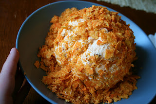 Perfect Fall Cheese Ball - Rolling cheese ball in crushed chips