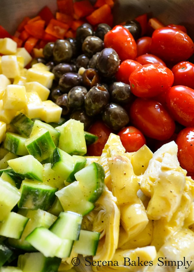 Cold Italian Tortellini Pasta Salad drizzle with dressing from Serena Bakes Simply From Scratch.
