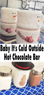 Keep warm this winter with a hot chocolate bar that will be as cute as it is helpful. With just a few items you may already have, you can make a super cute Snowman Hot Chocolate bar that will keep you warm when it's cold outside with a warm cup of cheer. #hotchocolatebar #snowman #hotchocolate #dessertbar #diypartymomblog