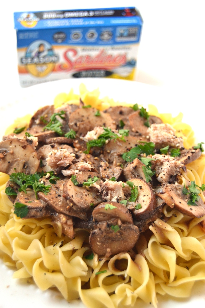 Healthier Sardine Stroganoff features sauteed mushroom, onions and garlic with a Greek yogurt based balsamic-wine sauce and omega-3 rich sardines served over egg noodles! www.nutritionistreviews.com